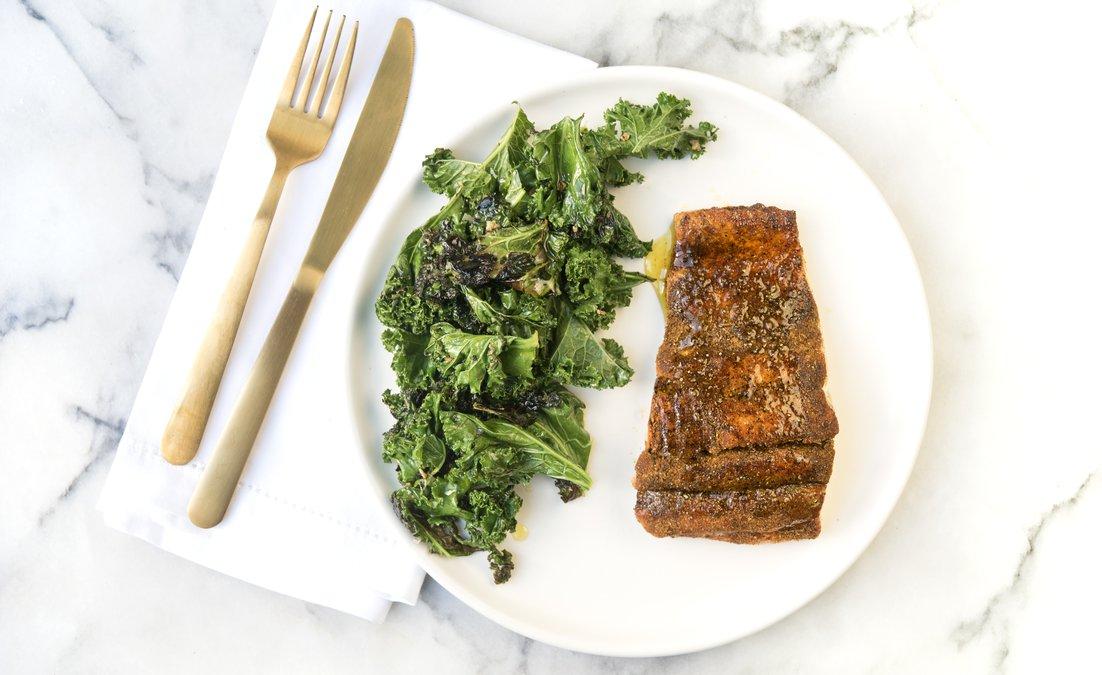 Yummy keto friendly moroccan-spiced salmon with sautéed kale.